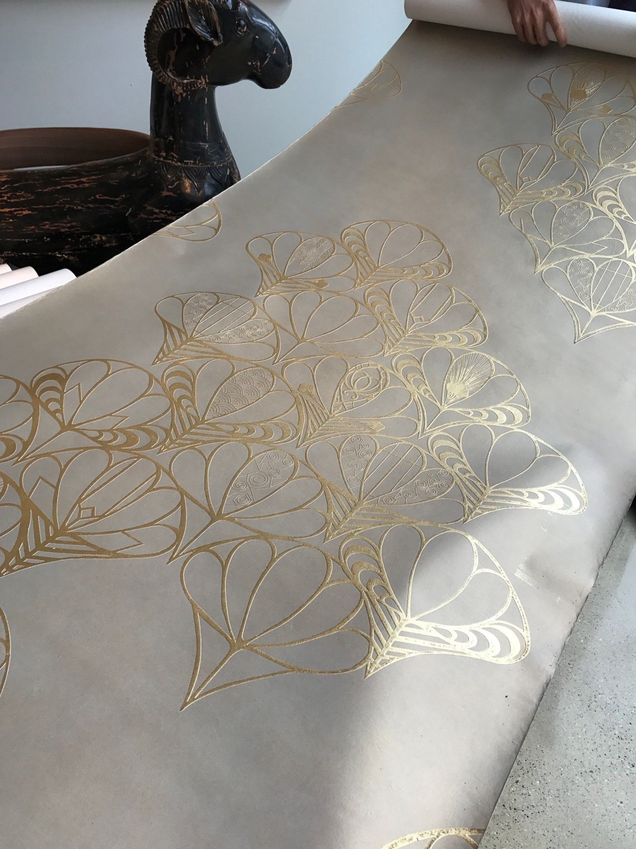 bas relief design with gold leaf